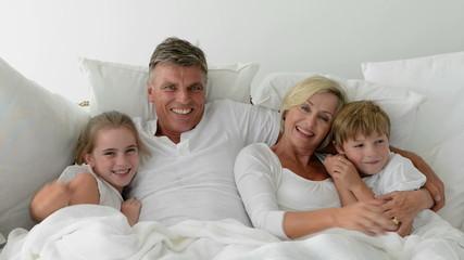 Grandparents and grandchildren in bed