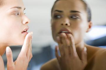 Woman facing mirror