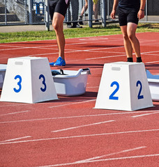 Men at the starting block of the running track