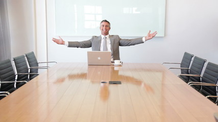 Executive alone in meeting room