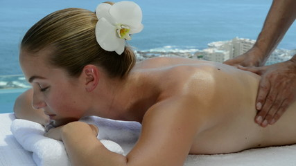 Shoulder massage by the sea