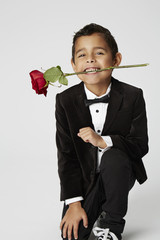 Romantic boy holding rose