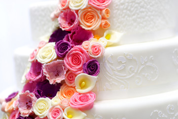 White wedding cake decorated with sugar flowers