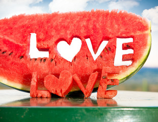 Fresh juicy watermelon slice  with love letters word