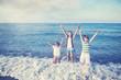 Children happy running at the  beach