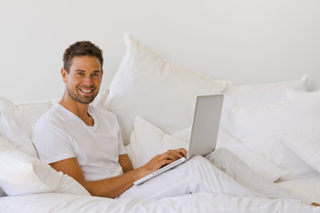 Young man  surfing the net on sofa