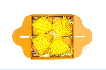 Ripped mangoes in a paper box