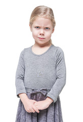 Angry beautiful little girl frown isolated
