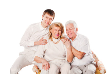 Happy smiling senior couple with son. Isolated on white