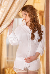 Pregnant woman in white shirt