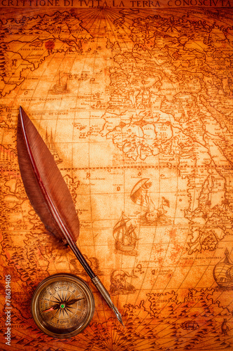 canvas print picture Vintage magnifying glass lies on an ancient world map