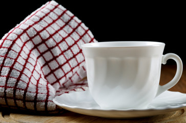 White coffee cup and towel closeup