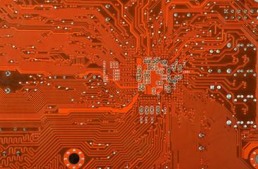 Close up of a printed orange computer circuit board