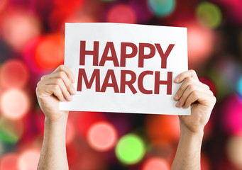 Happy March card with colorful background with defocused lights