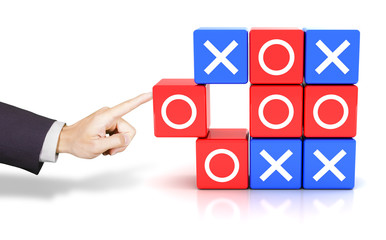 Hand pushing a circle to win the tic tac toe game