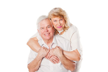 Happy smiling senior couple in love. Isolated on white.