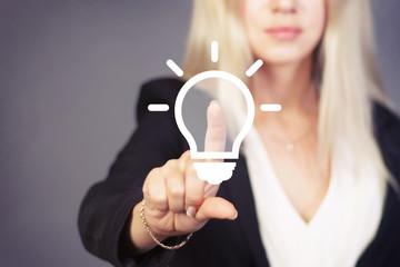 Businesswoman touch button idea bulb icon