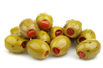 stuffed green olives on a white background