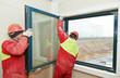 two workers installing window - 78643235