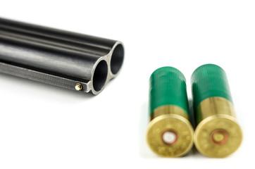 Barrel shotgun and cartridges on a white background