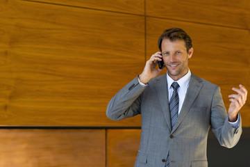 Businessman phoning portrait