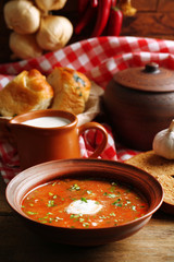Ukrainian beetroot soup - borscht in bowl and pot,