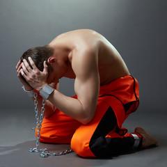 Concept of imprisonment. Prisoner grabbed his head