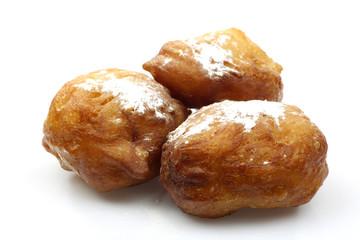 baked traditional dutch oliebollen with powdered sugar