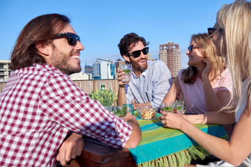 Friends party gathering on rooftop