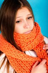 girl in orange scarf sad
