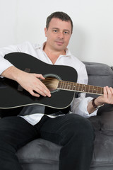 A cheerful man with his guitar