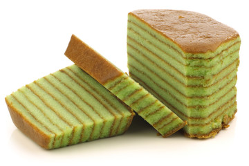 "Indonesian layered cake called ""spekkoek"" on a white background"