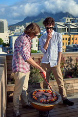 Two men barbecuing