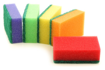 colorful abrasive pads on a white background