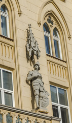 Statue of a knight on a house in Lviv