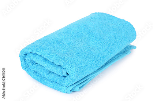 Leinwanddruck Bild Blue towel isolated on white background