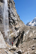 Tourist looks at highest waterfall