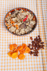 Hot delicious pilaf on a turkish dish on yellow tablecloth. With
