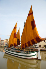 Italy, Cesenatico harbor antique sailing boat