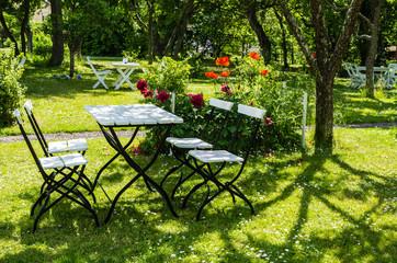 Garden furniture in a verdant park in Sweden.