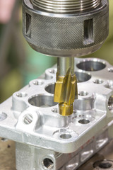 operator machining automotive parts by machining center