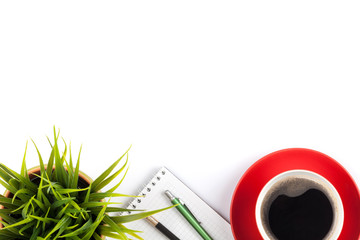 Office desk table with supplies, coffee cup and flower