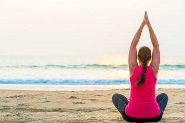 yoga in the fresh air on the beach