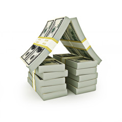 Stack of bills in the shape of a house on a white background.