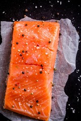Fresh salmon fillet with pepper and sea salt