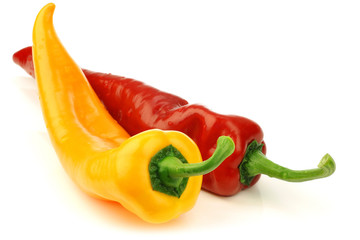red and yellow sweet pepper(capsicum) on a white background