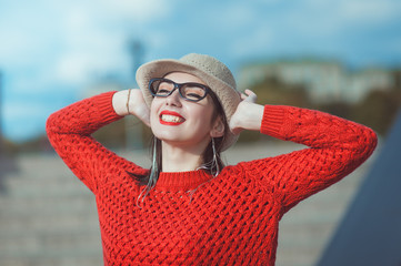 Young beautiful hipster girl in hat and glasses enjoy sunlight