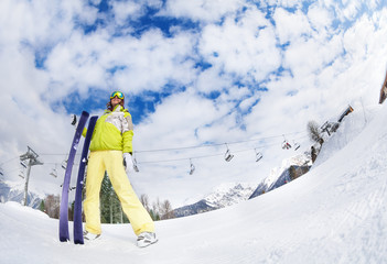 Young woman in mask holding ski fisheye view