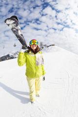 Young woman going mountain ski on winter resort