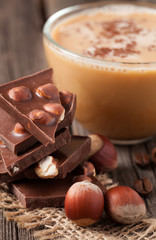 Stack of chocolate with nuts beans of coffe and star anise